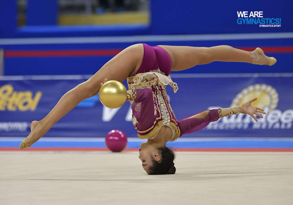 Alexandra Agiurgiuculese performs her unique head walkover during her routine with the Ball on Tuesday at the World Rhythmic Gymnastics Championships in Sofia.